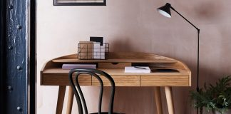 The image shows a small and smart desk used in a small space