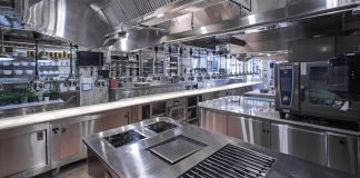 The image shows a nice restaurant kitchen with a brilliant layout.