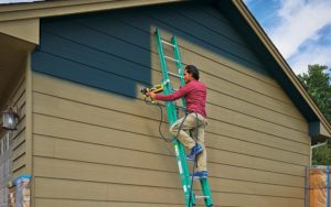How to use a paint sprayer outdoors?